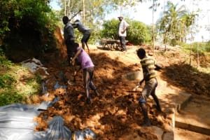 The Water Project: Malekha West Community, Soita Spring -  Backfilling With Soil