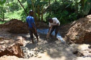 The Water Project: Malekha West Community, Soita Spring -  Slab Setting