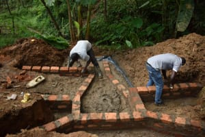 The Water Project: Malekha West Community, Soita Spring -  Wall Construction