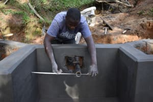 The Water Project: Malekha West Community, Soita Spring -  Pipe Setting
