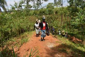 The Water Project: Malekha West Community, Soita Spring -  Community Hauling Rocks