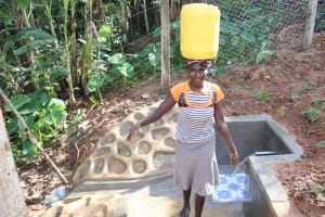 The Water Project: Malekha West Community, Soita Spring -  Endith Andayi Carrying Water