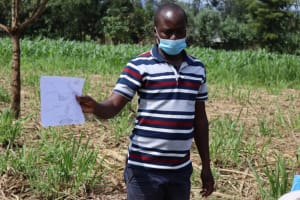 The Water Project: Malekha West Community, Soita Spring -  Training Using Charts