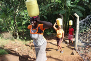 The Water Project: Malekha West Community, Soita Spring -  Women Carrying Water
