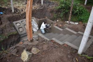 The Water Project: Malanga Community, Malava Housing Spring -  Plastering
