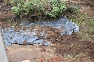 The Water Project: Malanga Community, Malava Housing Spring -  Backfilling With Soil