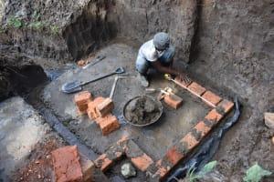 The Water Project: Malanga Community, Malava Housing Spring -  Brick Setting