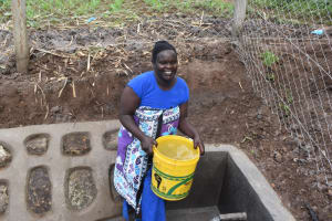 The Water Project: Malanga Community, Malava Housing Spring -  Carrying Water