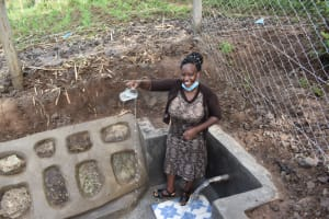 The Water Project: Malanga Community, Malava Housing Spring -  Every Drop Counts