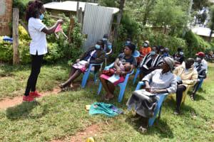 The Water Project: Malanga Community, Malava Housing Spring -  Mask Making Session