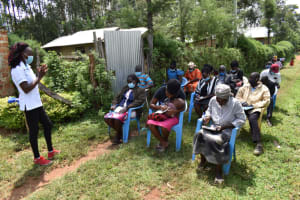 The Water Project: Malanga Community, Malava Housing Spring -  Participants Take Notes At Training