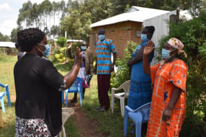The Water Project: Malanga Community, Malava Housing Spring -  Practicing Contactless Greetings