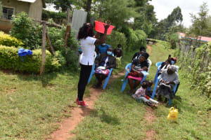 The Water Project: Malanga Community, Malava Housing Spring -  Safe Water Handling Session