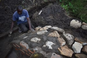 The Water Project: Bukhaywa Community, Violet Inganji Spring -  Plastering The Stone Pitching