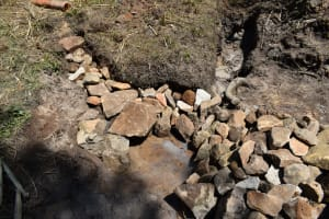 The Water Project: Bukhaywa Community, Violet Inganji Spring -  Backfilling With Rocks