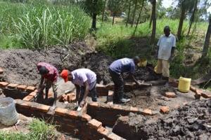 The Water Project: Bukhaywa Community, Violet Inganji Spring -  Wall Construction