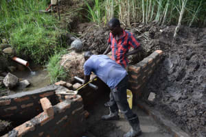 The Water Project: Bukhaywa Community, Violet Inganji Spring -  Pipe Setting