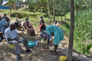The Water Project: Bukhaywa Community, Violet Inganji Spring -  Facilitator Demonstrates How To Make A Simple Kitchen Garden