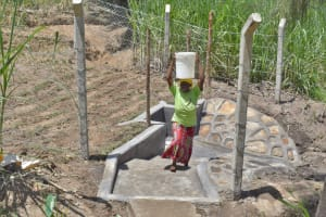 The Water Project: Bukhaywa Community, Violet Inganji Spring -  Leaving The Spring With Water