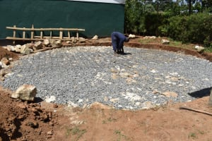 The Water Project: Friends School Manguliro Secondary -  Laying Wire Reinforcement To Hold Stones Together