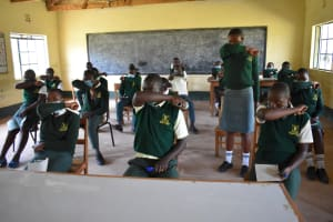 The Water Project: Friends School Manguliro Secondary -  Covid Sensitization Coughing Into The Elbow