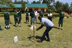 The Water Project: Friends School Manguliro Secondary -  Handwashing Demonstration Using Tippy Tap