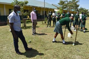The Water Project: Friends School Manguliro Secondary -  Trainers Watch As A Student Demonstrates Handwashing Steps