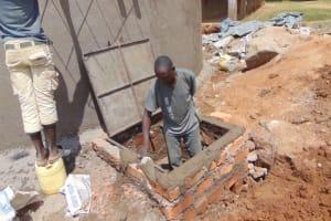 The Water Project: St. Kizito Kimarani Primary School -  Manhole Cover Placement