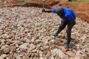 The Water Project: St. Kizito Kimarani Primary School -  Breaking Down The Rocks To Level Them