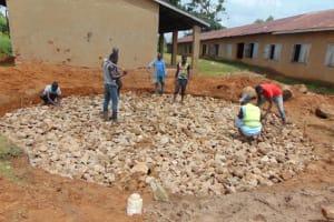 The Water Project: St. Kizito Kimarani Primary School -  Laying Stone Foundation