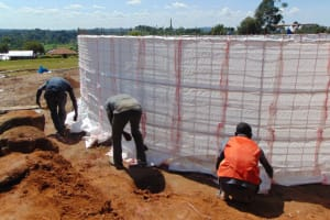 The Water Project: St. Kizito Kimarani Primary School -  Tying The Sugar Sacks Into Place