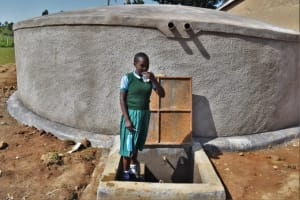 The Water Project: St. Kizito Kimarani Primary School -  Chelsea Enjoying A Drink From The Tank