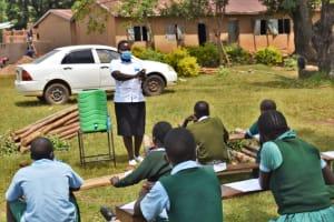 The Water Project: St. Kizito Kimarani Primary School -  Ms Betty Leading The Handwashing Exercise