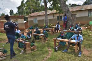 The Water Project: St. Kizito Kimarani Primary School -  Ms Olivia Leading The Session