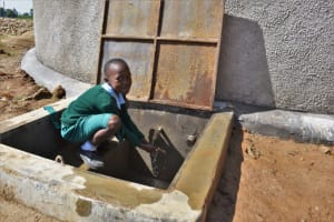 The Water Project: St. Kizito Kimarani Primary School -  Pupil Posing At The Water Point
