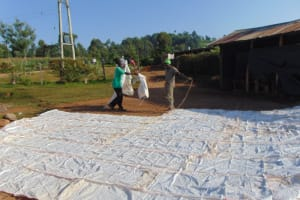 The Water Project: Kapsegeli KAG Primary School -  Sewing Sugar Sacks Onto Dome Frame