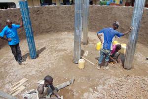 The Water Project: Kapsegeli KAG Primary School -  Erecting The Pillars