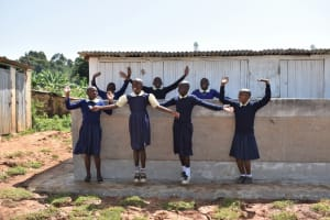 The Water Project: Kapsegeli KAG Primary School -  Girls Celebrating At Their Latrines