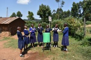 The Water Project: Kapsegeli KAG Primary School -  Girls Use Handwashing Station