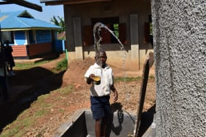 The Water Project: Kapsegeli KAG Primary School -  Student Celebrating For Reliable Water