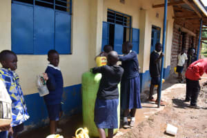 The Water Project: Kapsegeli KAG Primary School -  Students Bring Water For Construction