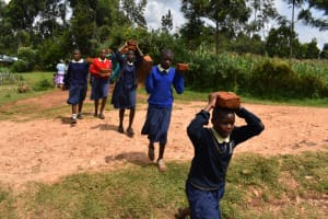 The Water Project: Kapsegeli KAG Primary School -  Students Help With Bricks