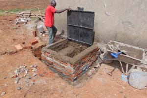 The Water Project: Gimengwa Primary School -  Manhole Cover Placement