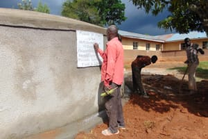 The Water Project: Gimengwa Primary School -  Plaque Writing And Site Clearance