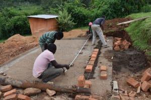 The Water Project: St. Joakim Buyangu Primary School -  Brickwork Setting