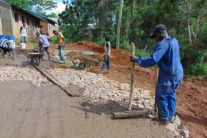 The Water Project: St. Joakim Buyangu Primary School -  Concrete Placement