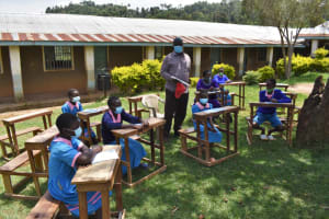 The Water Project: St. Joakim Buyangu Primary School -  Bom Member Participating In Training
