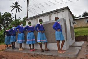 The Water Project: St. Joakim Buyangu Primary School -  Girls Posing At The Vip Latrines