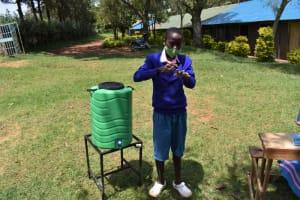 The Water Project: St. Joakim Buyangu Primary School -  Pascal Demonstrating Hand Washing