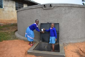 The Water Project: St. Joakim Buyangu Primary School -  Water Flowing